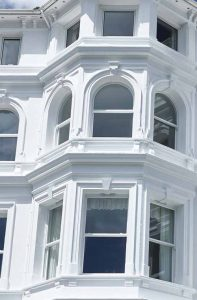 Heritage Rose sash windows arched and straight edges
