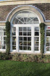 White uPVC sash windows with georgian detail