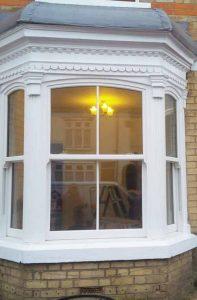 Large white uPVC sash windows
