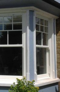 Ultimate Rose uPVC sash window with astragal bars