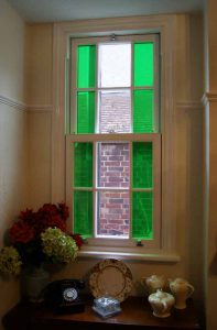 uPVC vertical slider with decorative glass