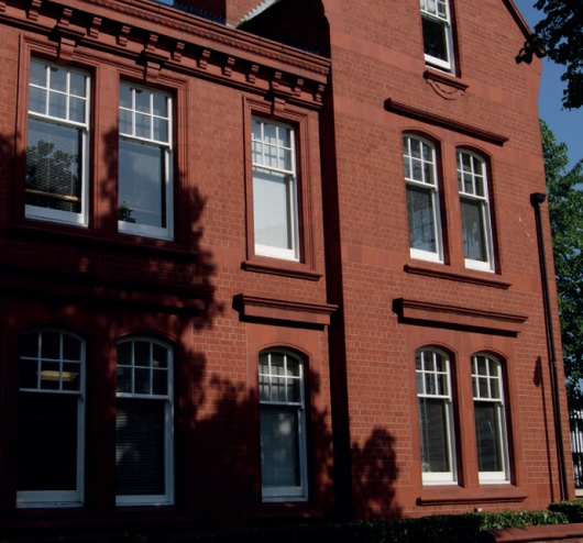 commercial sash window installation red brick building