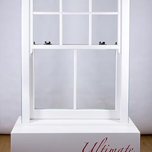 a white sash window on a white plinth