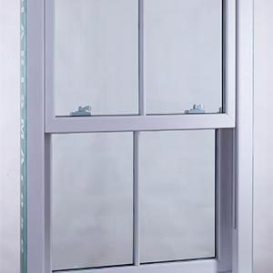 A white sash window with astragal bars