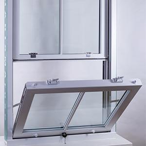 A slide and tilt window open on a white plinth