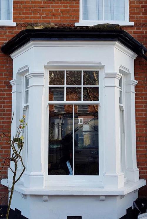 Sliding sash white bay window