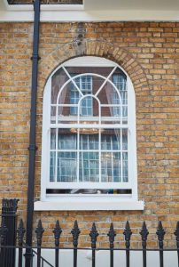 white sliding sash arch window