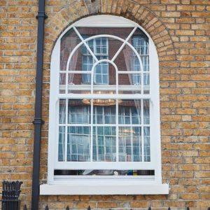 white sliding sash arch window