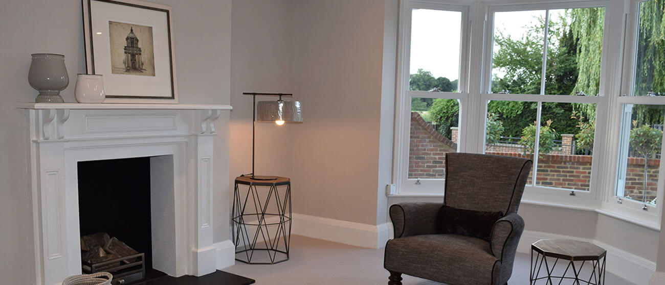 Living Room with white wash walls and fireplace