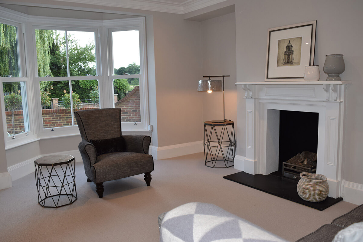 Millwater cottage living room interior with victorain sliders