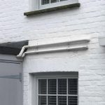 Two grey timber sash windows after installation