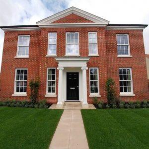 Heritage rose windows on bespoke red brick house