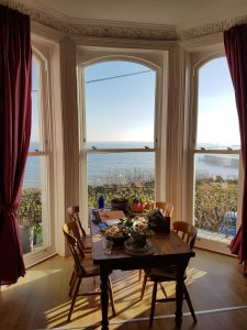Heritage rose windows with view of the sea