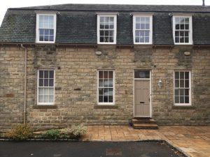 ultimate rose windows on stone cottage