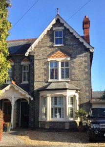 ultimate rose windows on grey stone house
