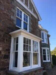 ultimate rose white sash windows on grey brick house
