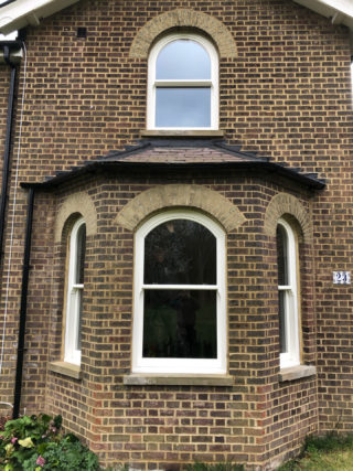 white ultimate Roseview Windows, arches, bay